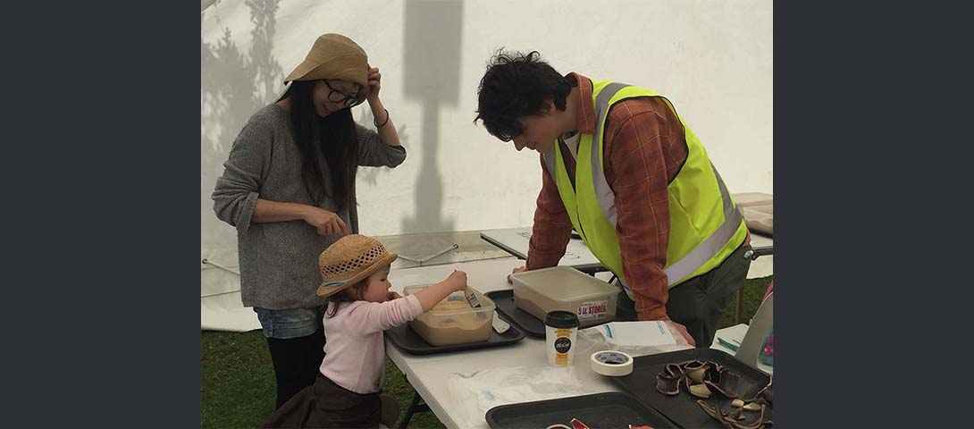 Young volunteer assisting in the archaeology tent